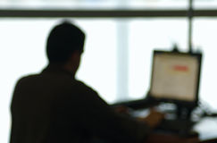 Laptop User (blurred). Laptop user at an Airport Stock Image