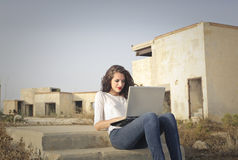 Laptop using next to the ruins Royalty Free Stock Photo