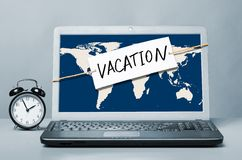 Laptop with vacation note Stock Photos