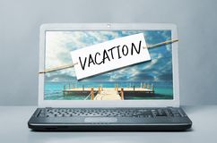 Laptop with vacation note. Laptop with note about vacation royalty free stock image