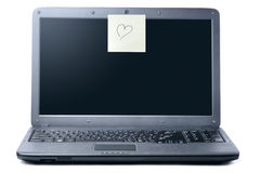 Laptop with valentine sticky note Royalty Free Stock Photos