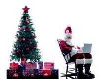 Laptop van de Kerstman geïsoleerd computersilhouet Royalty-vrije Stock Afbeelding