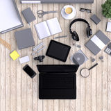 Laptop with variety blank office objects organized for company presentation or branding identity with blank modern devices. Royalty Free Stock Image