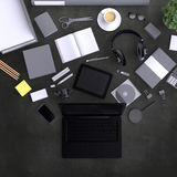 Laptop with variety blank office objects organized for company presentation or branding identity with blank modern devices. Mockup  on clear background. Top Stock Images