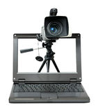 Laptop with video camera on tripod Stock Photography