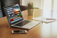 Laptop with a video edit project in the screen. Royalty Free Stock Photo