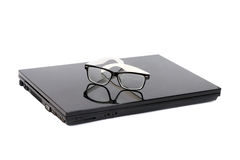 Laptop with vintage glasses Royalty Free Stock Images