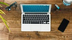 Laptop on Vintage Wooden desktop Stock Images