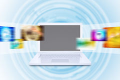 Laptop and virtual tape with colorful pictures Royalty Free Stock Photography