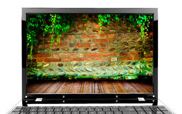Laptop with wall Royalty Free Stock Images