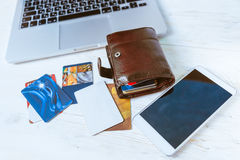 Laptop wallet glasses phone on table Stock Photography