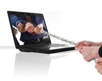 Laptop war. A black laptop computer with a tug of war Royalty Free Stock Images