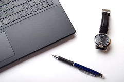 Laptop, watch and pencil Royalty Free Stock Photography