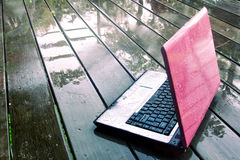 Laptop on wet floor Royalty Free Stock Images