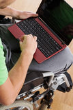Laptop and wheelchair Stock Image