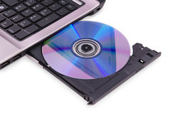 Laptop on white background. DVD disc in the drive. Royalty Free Stock Images