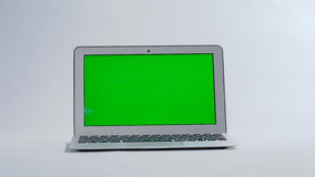 Laptop on white background, green screen.  Royalty Free Stock Photo