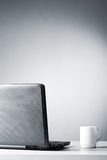 Laptop with white cup Stock Image