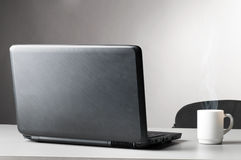 Laptop with white cup Stock Photo