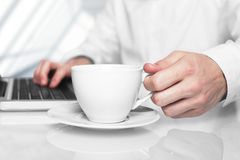 Laptop and white cup Stock Image