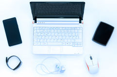 Laptop on white desk Royalty Free Stock Photography