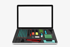 Laptop on white with office tools. As keyboard, clipping path included royalty free stock image