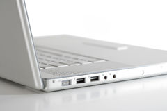 Laptop on white-sideview Royalty Free Stock Photos