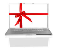 Laptop on White Wrapped in a Red Gift Bow Stock Photo