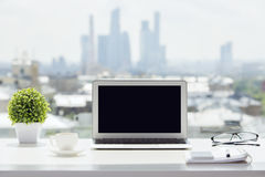 Laptop on windowsill Stock Photos