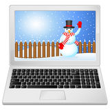 Laptop with winter landscape Stock Photo