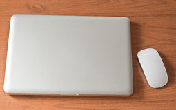 Laptop and wireless mouse Stock Photo
