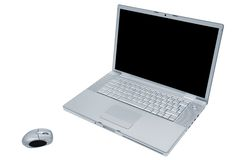 Laptop with the wireless mouse. Modern and fashionable laptop with the wireless mouse Royalty Free Stock Photo