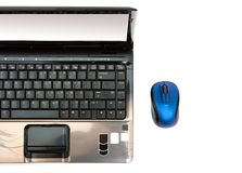 laptop and wireless mouse Royalty Free Stock Images