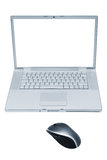 Laptop with the wireless mouse Royalty Free Stock Images