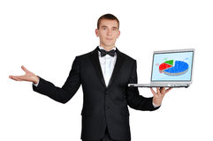 Laptop wirth chart. Businessman in tuxedo holding laptop wirth chart Royalty Free Stock Images