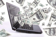 Laptop With 100 Dollars, Earn Money Royalty Free Stock Photo