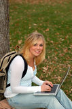 Laptop woman. Beautiful young woman student using laptop Stock Photo