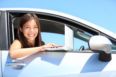 Laptop woman in car Royalty Free Stock Photography