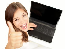 Laptop woman happy. Giving thumbs up success sign sitting at computer PC with excited face expression. Beautiful smiling cheerful multiracial Asian Caucasian Royalty Free Stock Photography
