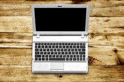 Laptop on wood background Royalty Free Stock Photography