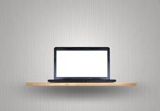 Laptop on wood shelf Royalty Free Stock Photography