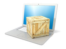 Laptop with wooden box package. Concept of online ordering of products. Side view. 3D render Stock Photo