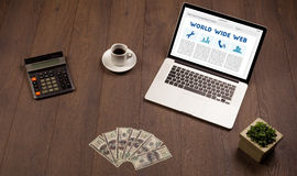 Laptop on wooden desk with office suplies Royalty Free Stock Images