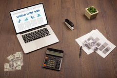 Laptop on wooden desk with office suplies Stock Photos