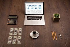 Laptop on wooden desk with office suplies Royalty Free Stock Photography