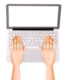 Laptop with wooden hand isolated Stock Image