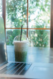 Laptop On Wooden Table At Coffee Shop Royalty Free Stock Photo