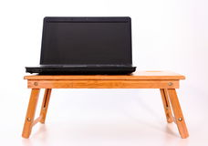 Laptop on a wooden table. Laptop computer on wooden table on a white background Stock Image