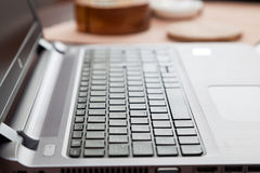 Laptop on wooden table in home Stock Photos