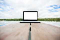 Laptop on wooden table Royalty Free Stock Photography